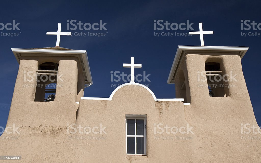 Adobe Mission Church With White Crosses in Taos, New Mexico stock photo