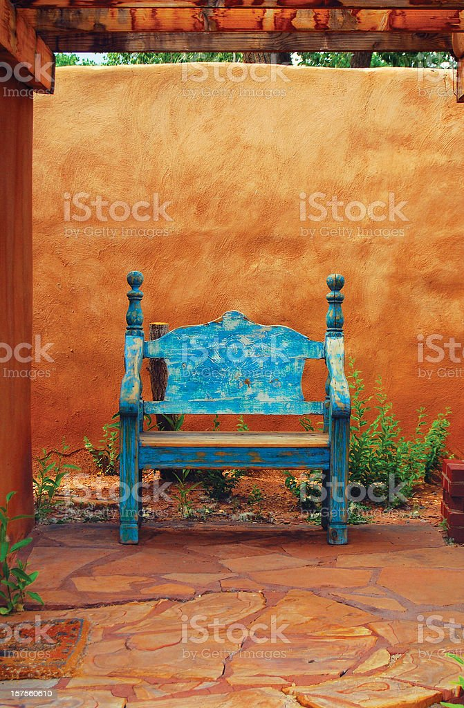 Adobe Patio with Wooden Bench royalty-free stock photo