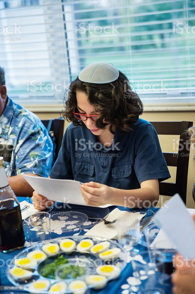 Adolescent boy participating at a Passover seder stock photo