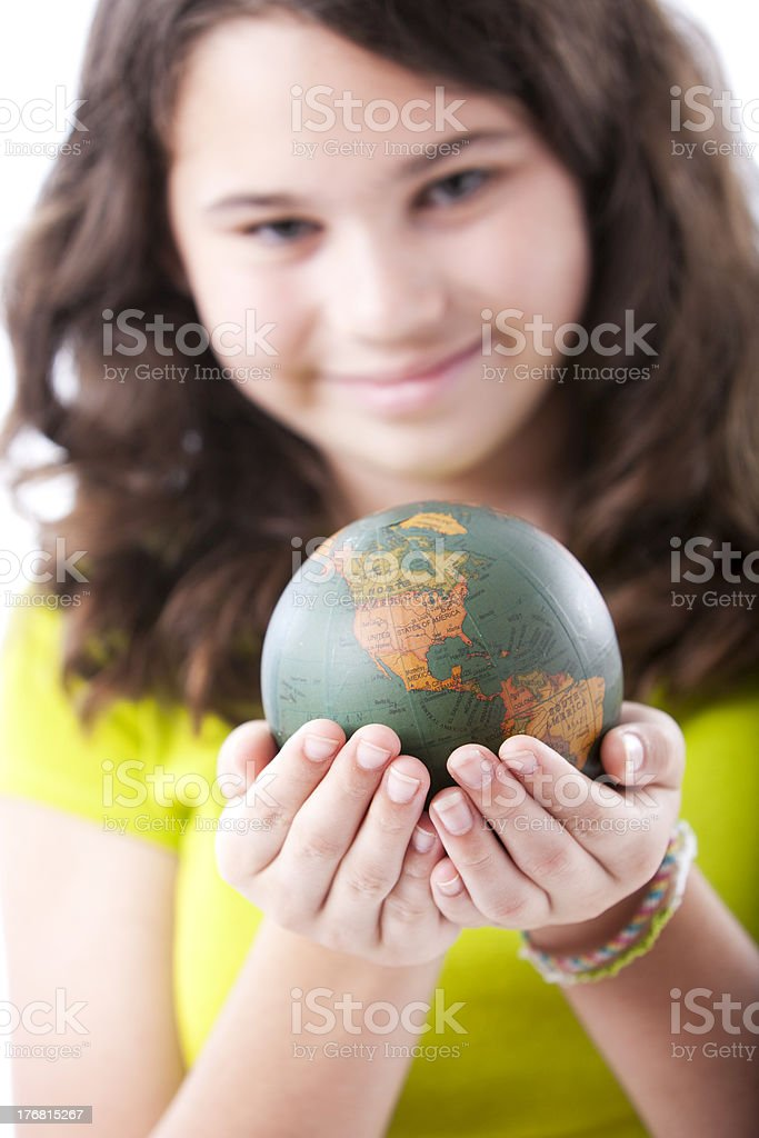 Adolescent Caucasion Girl Holding Small Globe or Earth royalty-free stock photo