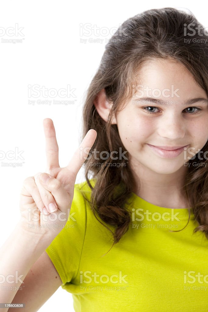 Adolescent  Caucasion Girl Makes a Peace Sign Closeup royalty-free stock photo