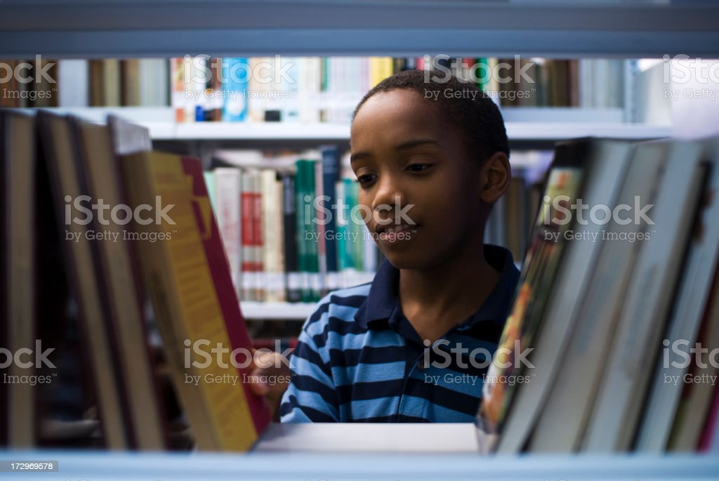Adolescent ready to read stock photo
