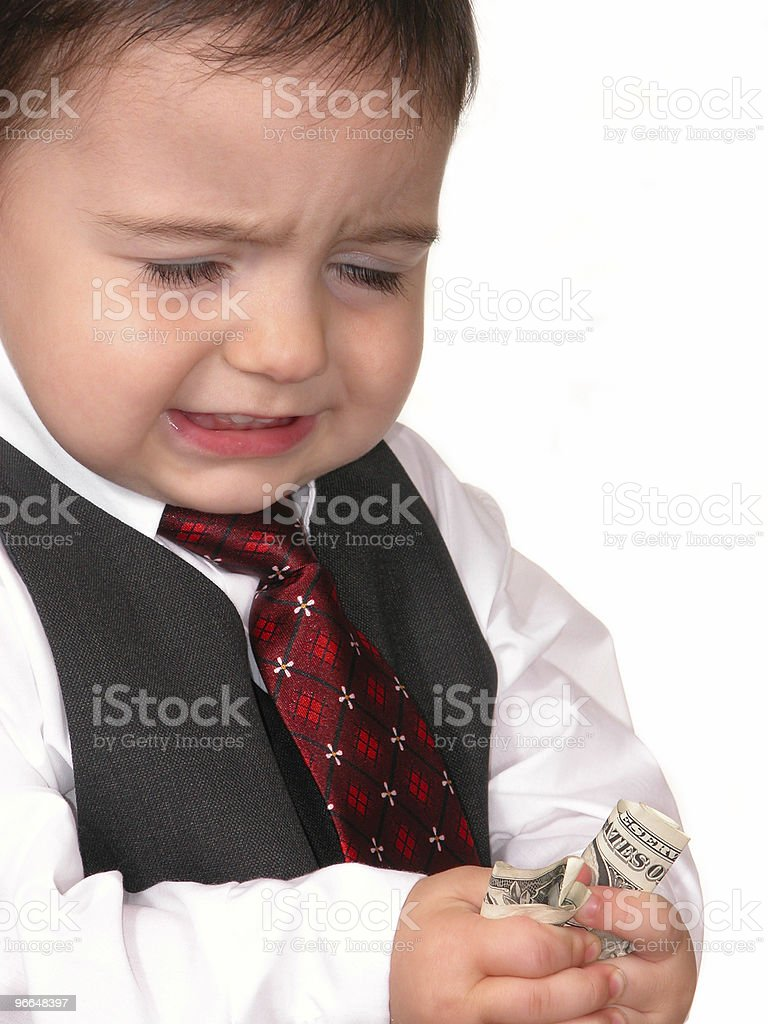 Adorable Baby Boy in Suit with Upset Expression royalty-free stock photo