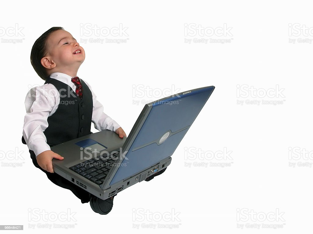 Adorable Baby Boy in Suit Working on a Laptop royalty-free stock photo