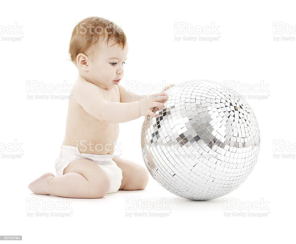 adorable baby boy with big disco ball royalty-free stock photo