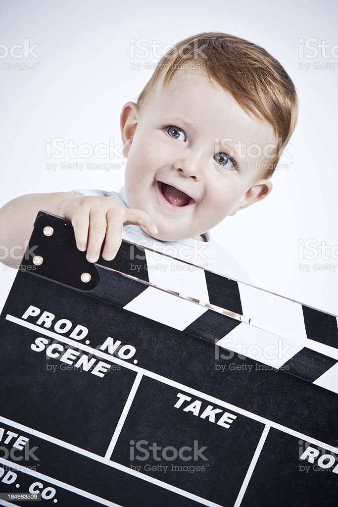 Adorable baby cine director. royalty-free stock photo