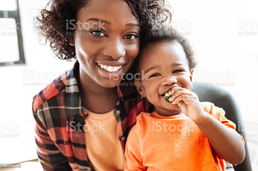Adorable baby eating snack royalty-free stock photo
