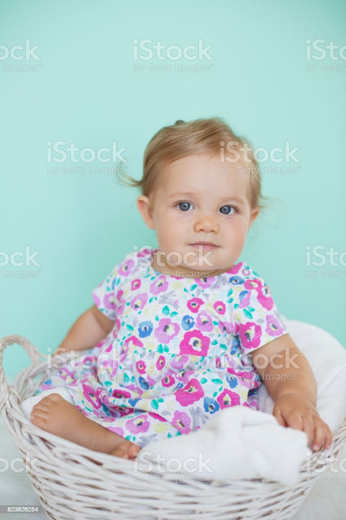 Adorable baby in basket stock photo