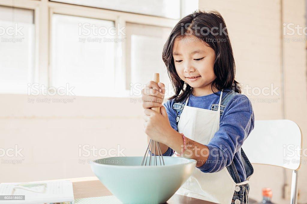 Adorable baker stock photo