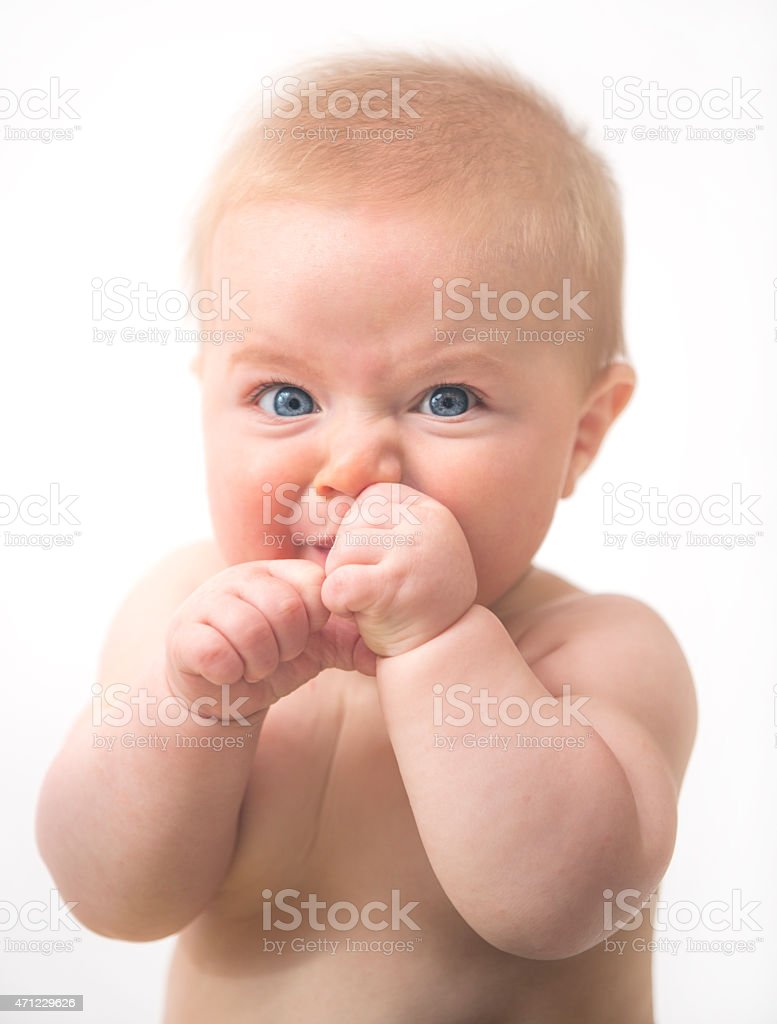 Adorable Blond Baby in a Fighting Stance stock photo