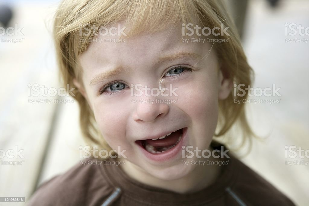 Adorable blond little girl crying portrait royalty-free stock photo