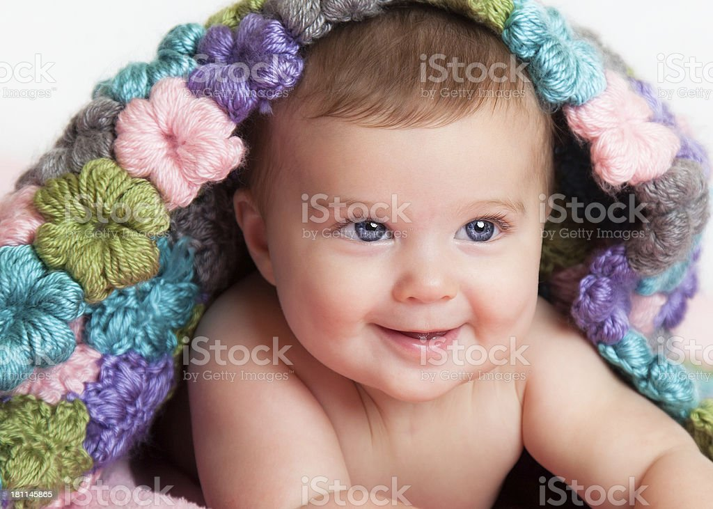 Adorable Blue Eyed Baby Under a Blanket royalty-free stock photo