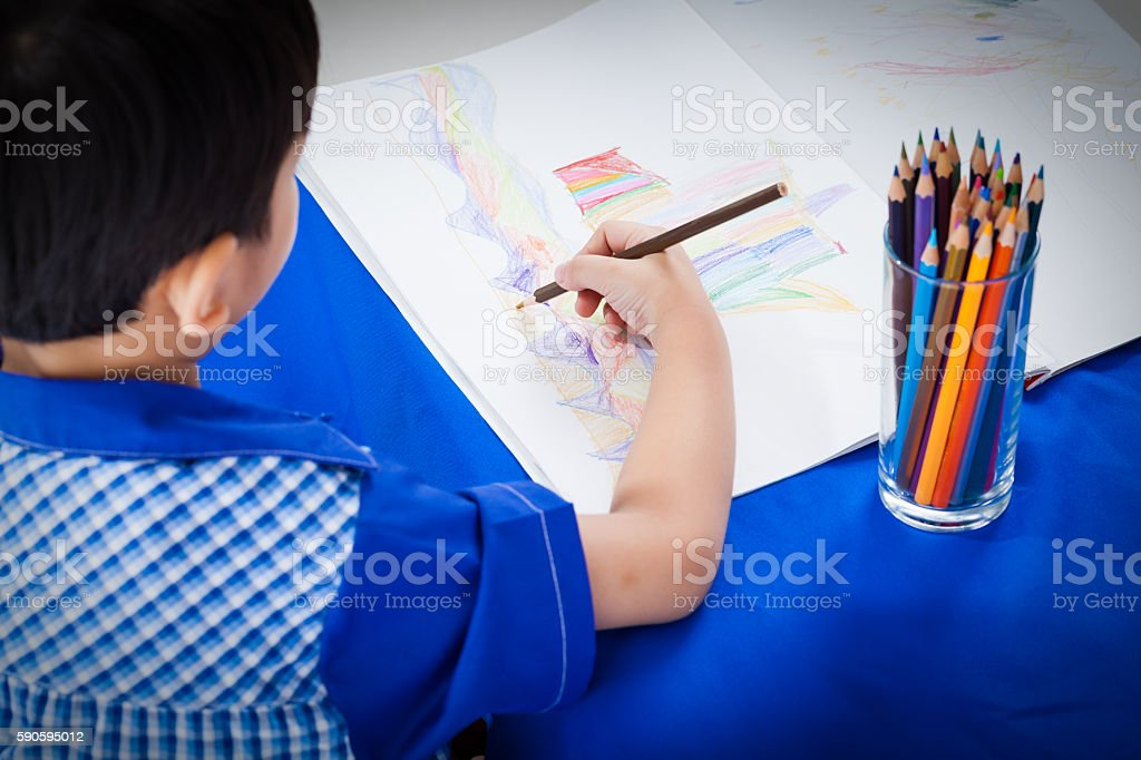 Adorable boy drawing picture stock photo