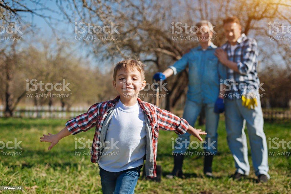 Adorable boy having fun in garden stock photo