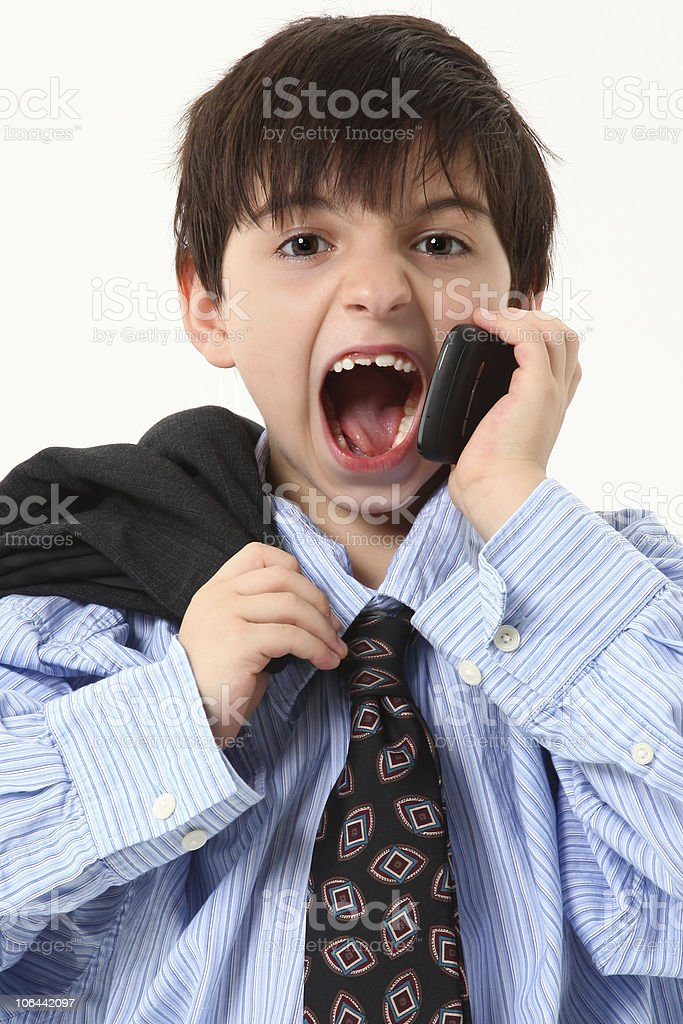 Adorable Boy in Baggy Suit with Cellphone stock photo