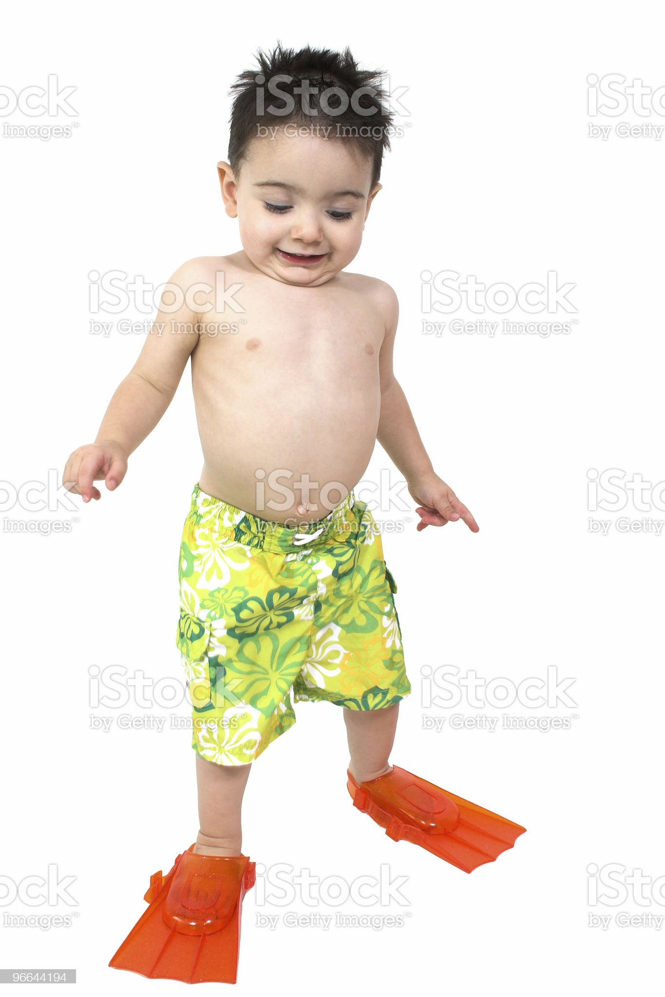 Adorable Boy Ready To Swim In His Bright Orange Flippers royalty-free stock photo