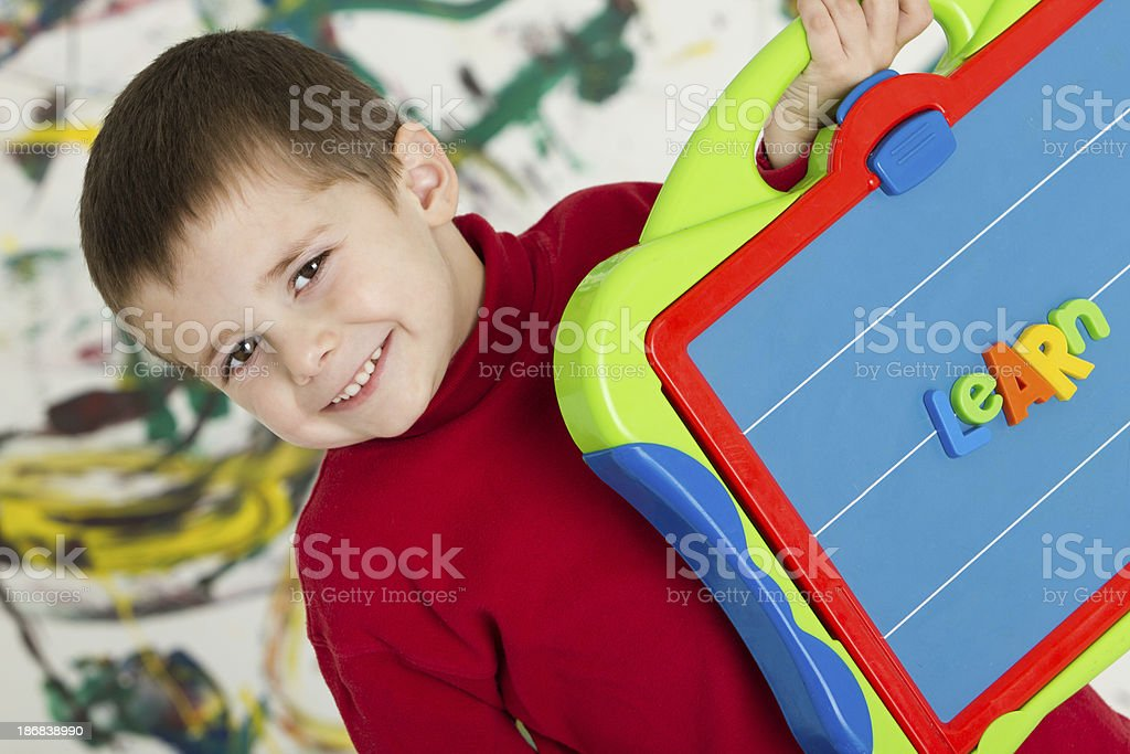 """Adorable boy showing the """"learn"""" word royalty-free stock photo"""