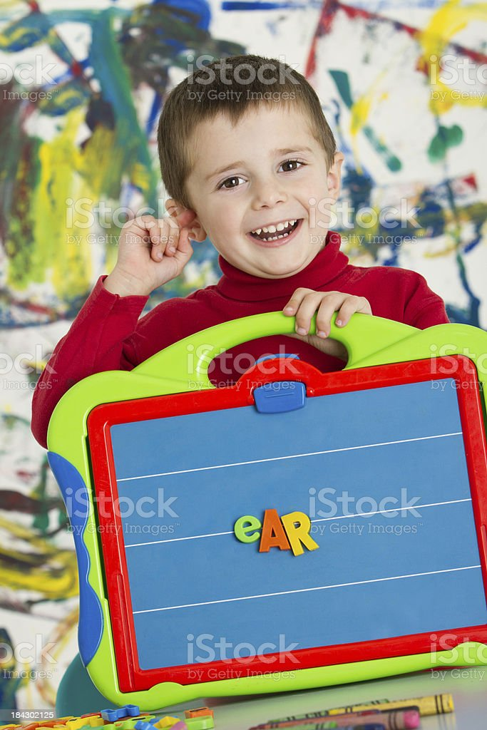 "Adorable boy showing the word ""ear"" royalty-free stock photo"