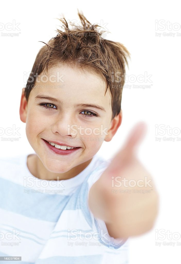 Adorable boy showing thumbs up and smiling over white background royalty-free stock photo