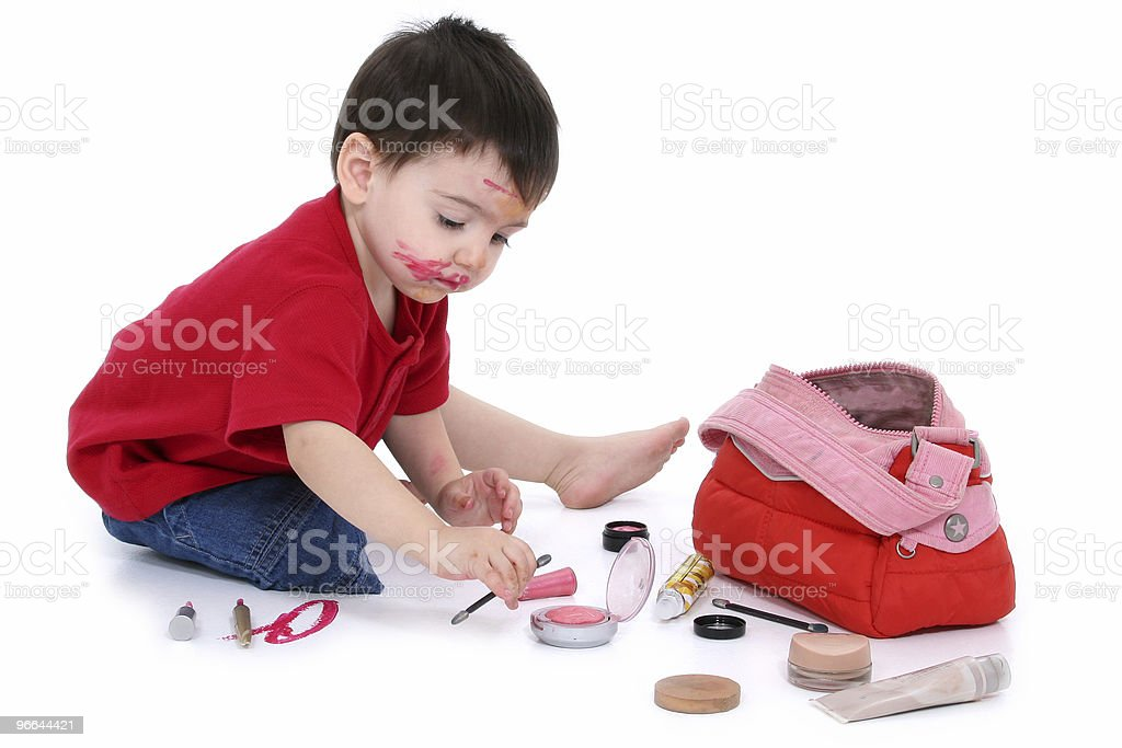 Adorable Boy Sneaks Into Moms Purse And Makes A Mess stock photo