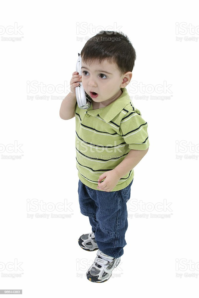 Adorable Boy Talking On House Phone Over White royalty-free stock photo