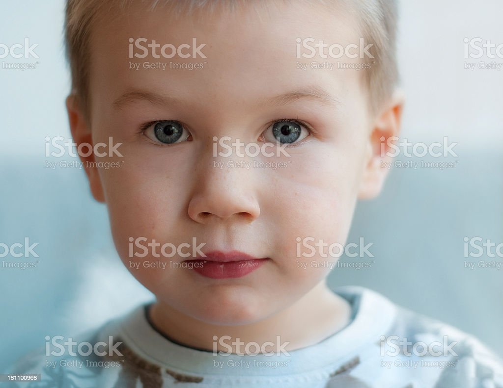 Adorable boy with blank expression | softfocus royalty-free stock photo