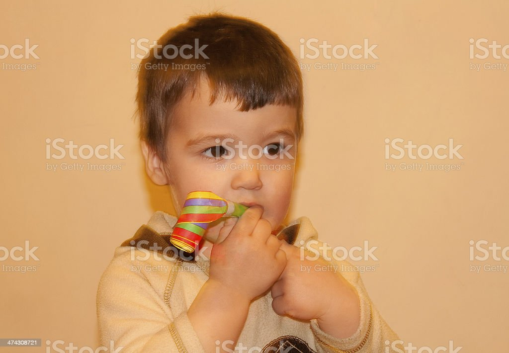 Adorable boy with horn blower stock photo