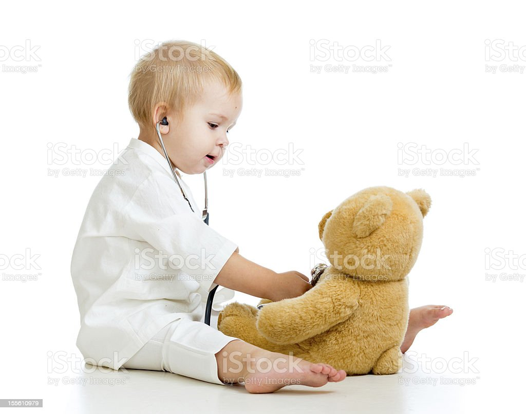 Adorable child with clothes of doctor and teddy bear royalty-free stock photo
