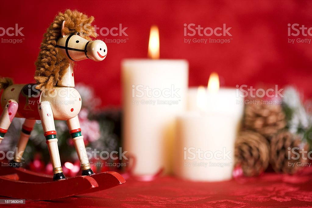 Adorable Christmas Rocking Horse with Candles and Decorations, Copy Space royalty-free stock photo