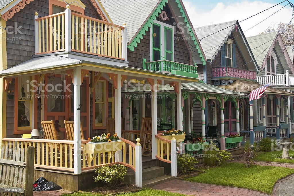Adorable cottages with brightly painted trim stock photo