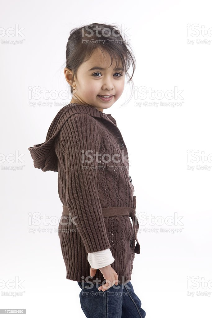 Adorable Ethnic Little Girl Fashion Model in Fall Sweater royalty-free stock photo