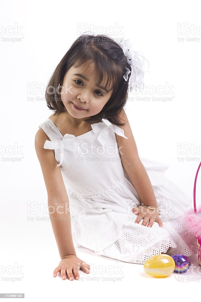 Adorable Ethnic Little Girl in Easter Dress at Camera royalty-free stock photo