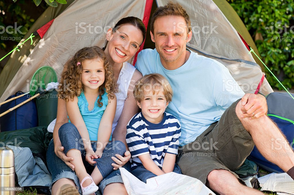 Adorable family camping together royalty-free stock photo