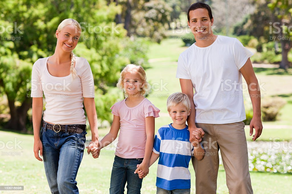 Adorable family in the park royalty-free stock photo