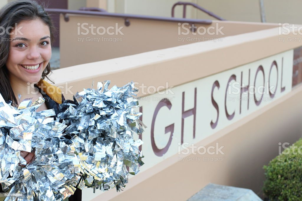 Adorable fifteen year old american girl cheerleader with pompoms stock photo