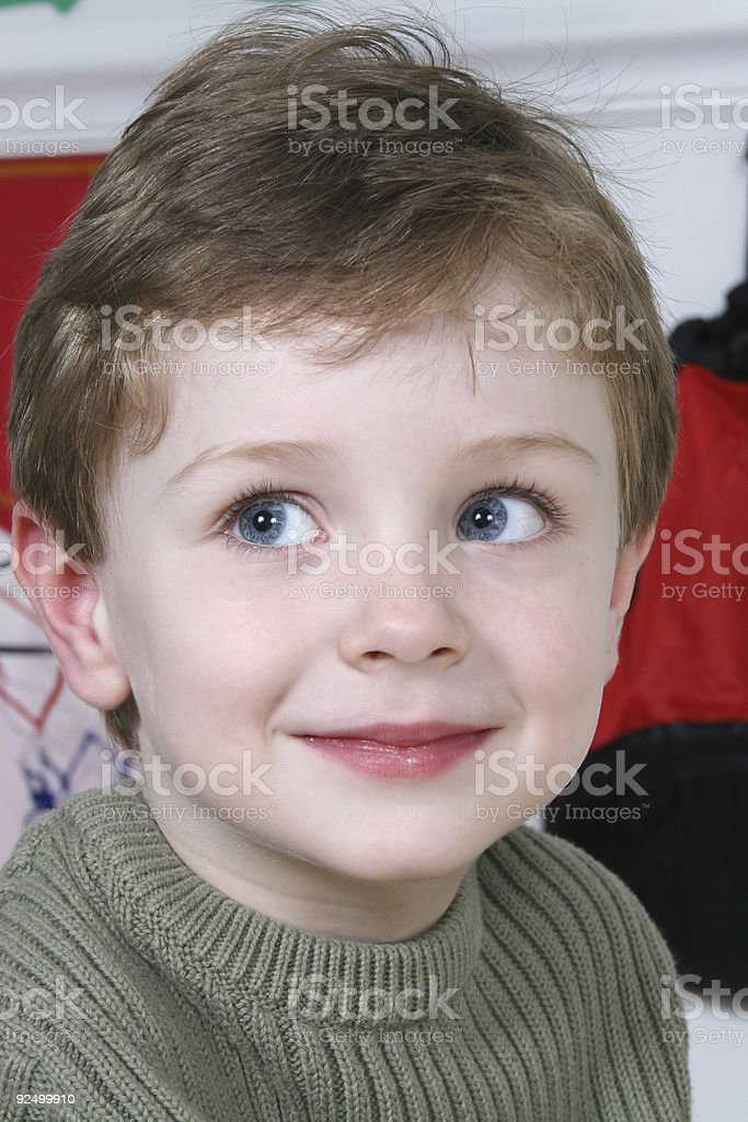 Adorable Four Year Old Boy with Big Blue Eyes royalty-free stock photo
