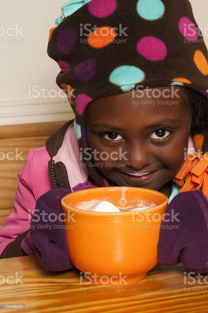 Adorable girl enjoying mug of hot chocolate royalty-free stock photo