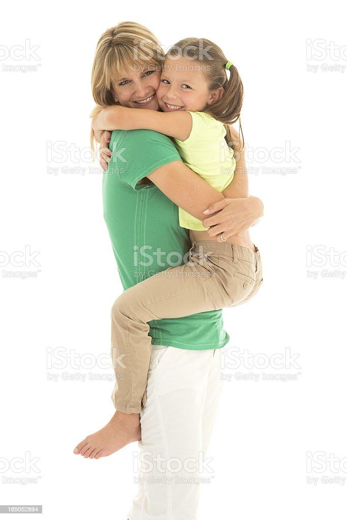 Adorable Girl Gives Mom a BIG Hug stock photo