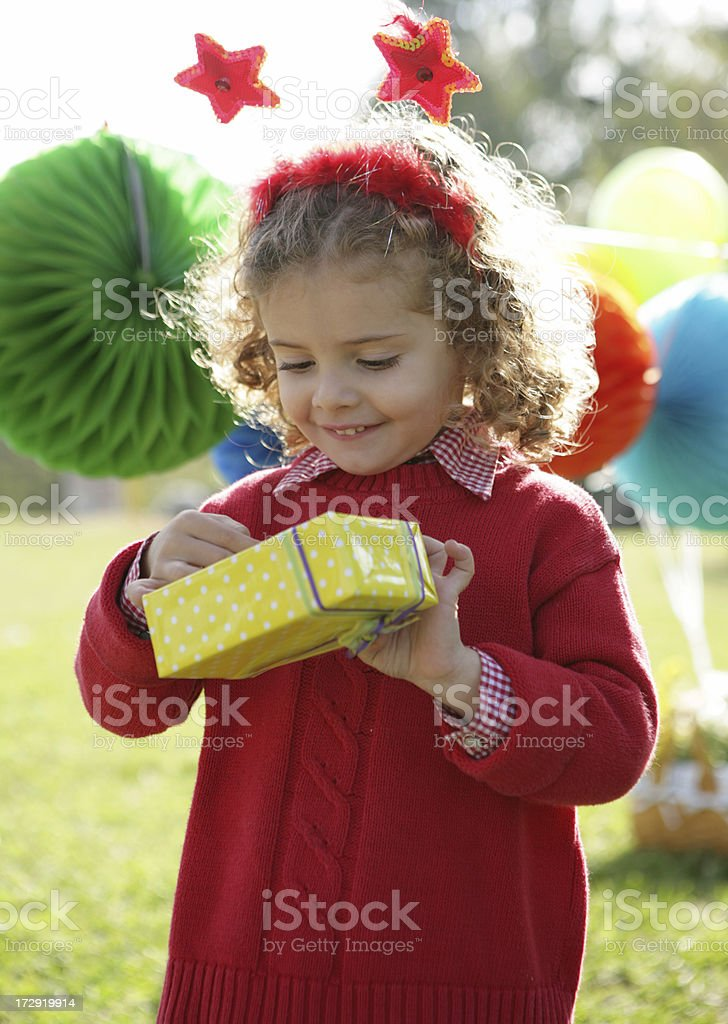 adorable girl hold a gift royalty-free stock photo