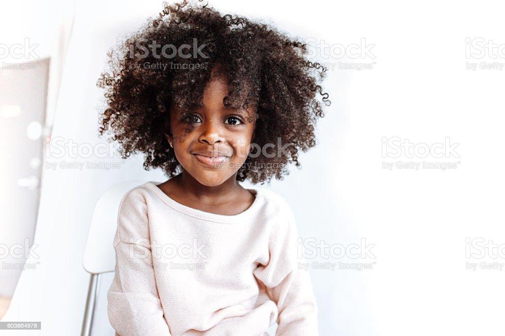 Adorable girl looking at camera stock photo