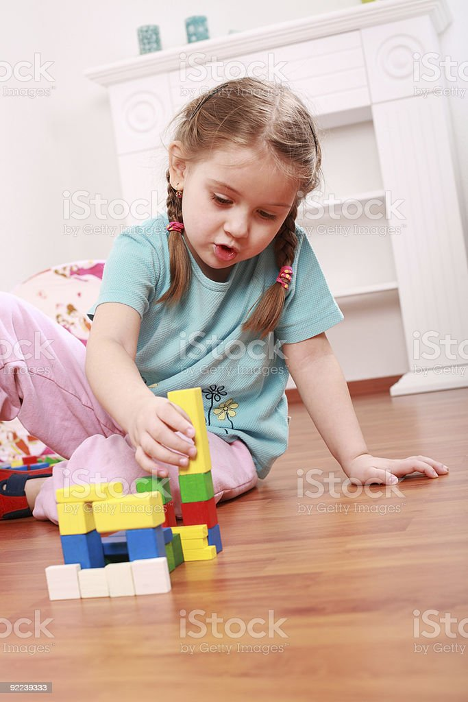 Adorable girl playing with blocks royalty-free stock photo