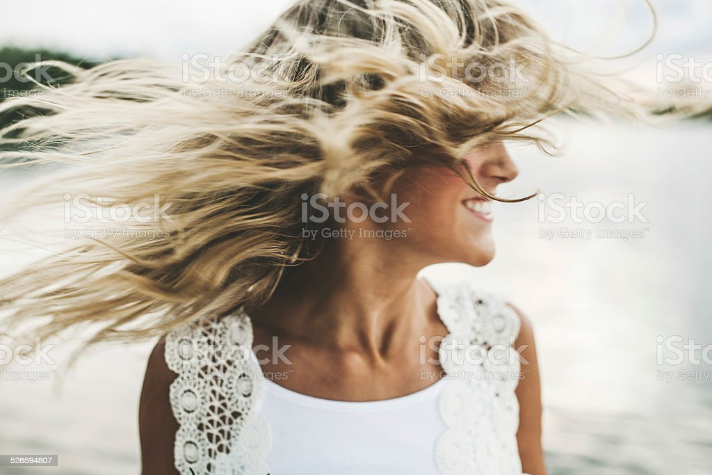 Adorable girl swinging her face stock photo