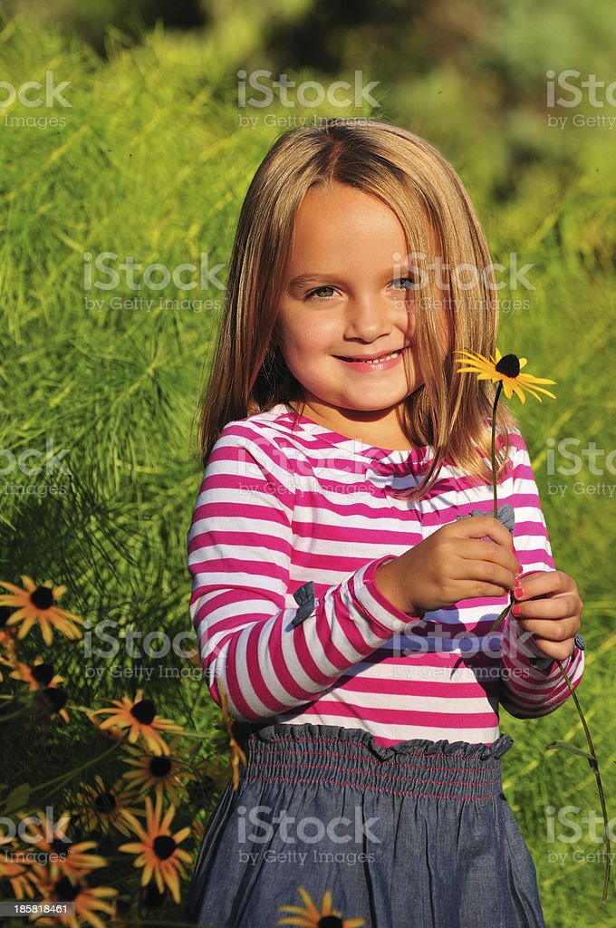 adorable girl with a flower royalty-free stock photo