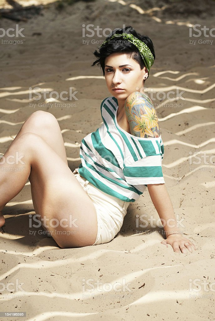 adorable girl with tattoo on the beach royalty-free stock photo