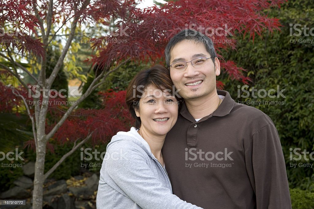 Adorable Happy Asian Adult Couple Posing for Outdoor Portrait, Copyspace royalty-free stock photo