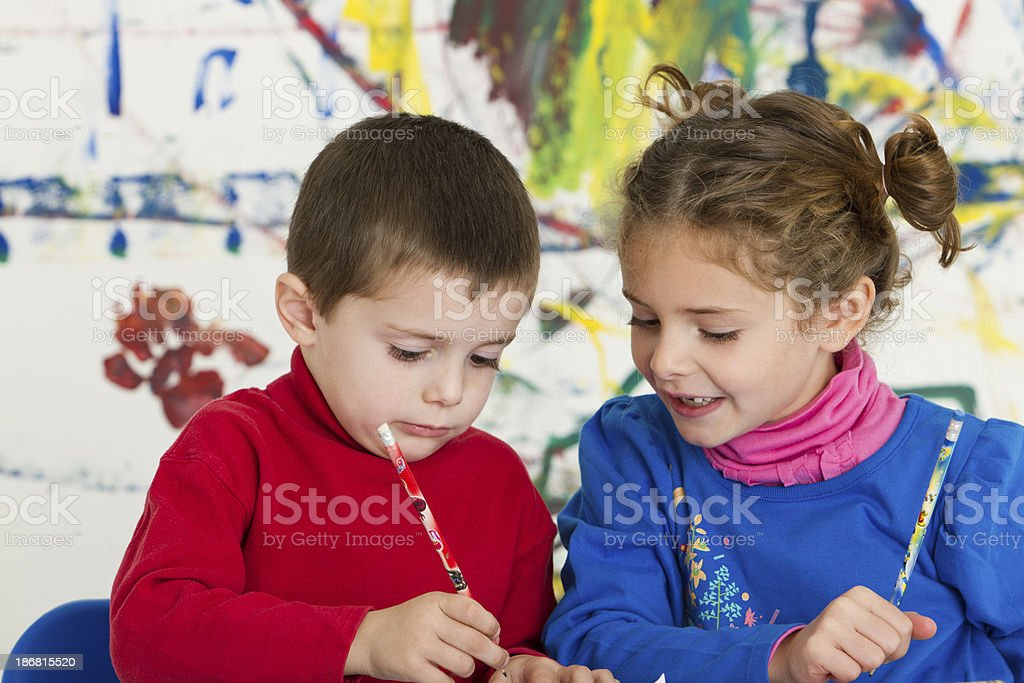 Adorable kids painting and drawing royalty-free stock photo