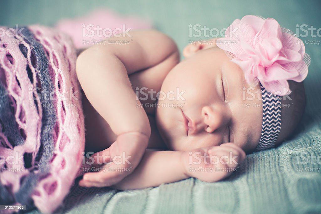 Adorable Little Baby Girl With Flower Headband stock photo