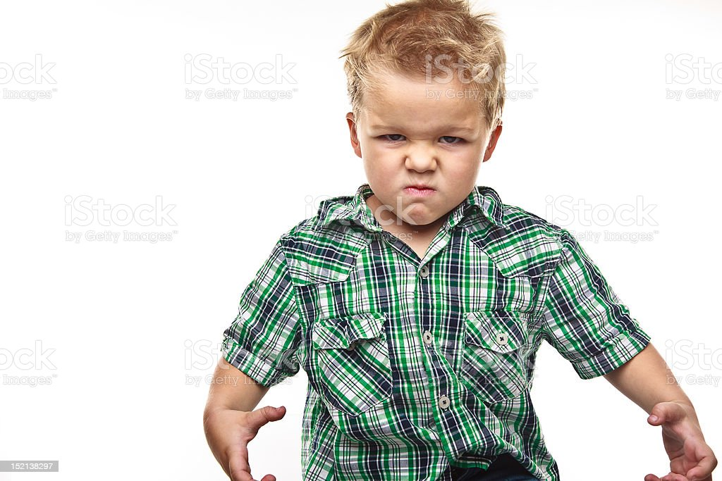 Adorable little boy looking angry. royalty-free stock photo
