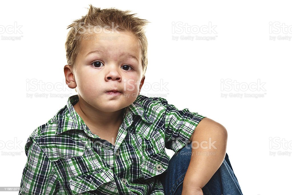 Adorable little boy looking pensive. royalty-free stock photo