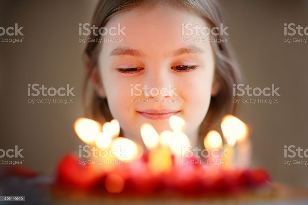 Adorable little girl and a raspberry cake stock photo